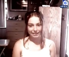 Naughty teenage doll playing before web cam