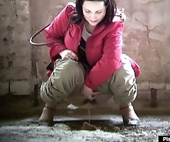 Brunette hotsy urinating under spycam control